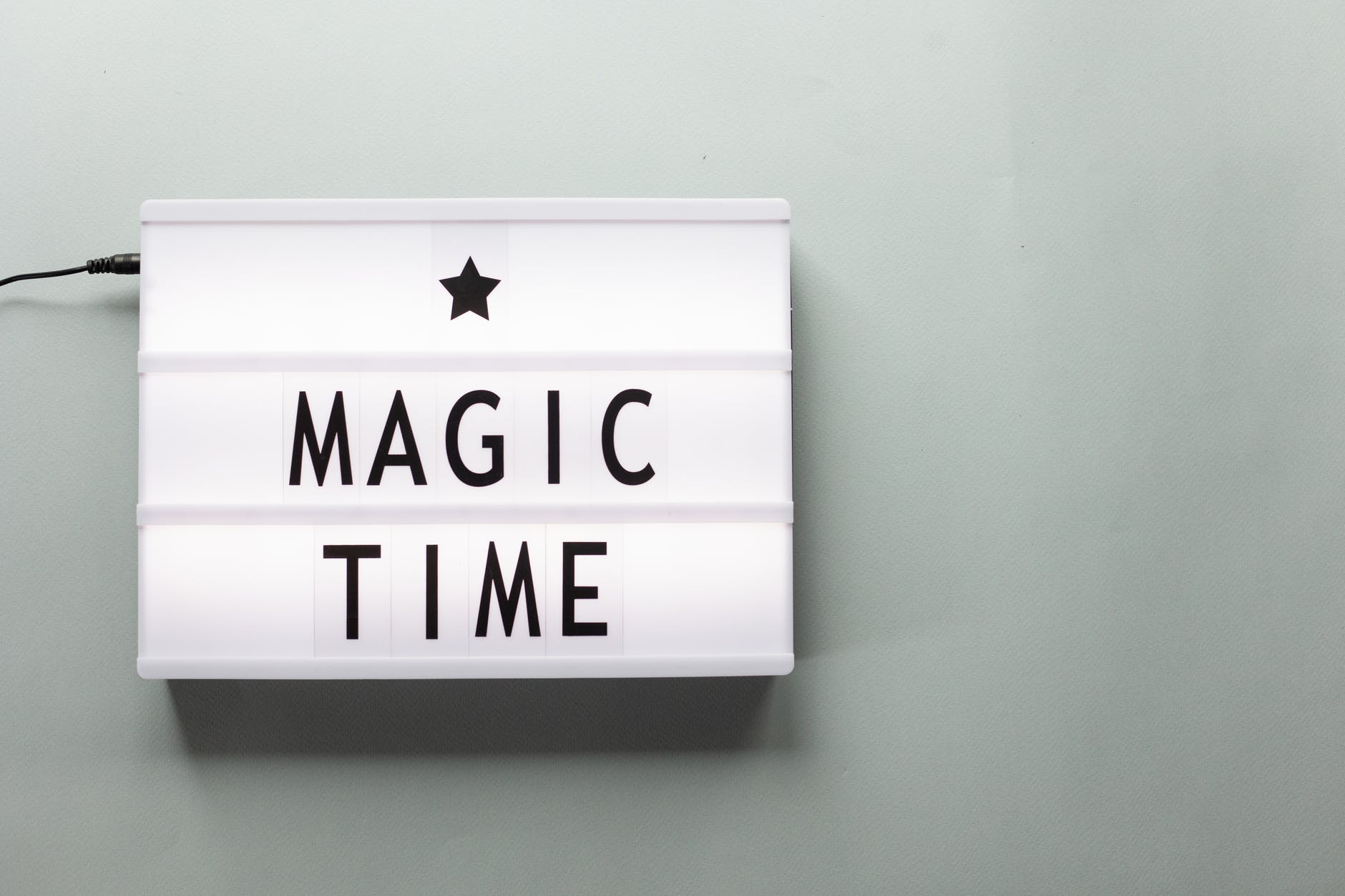 magic time title on light box during new year holiday